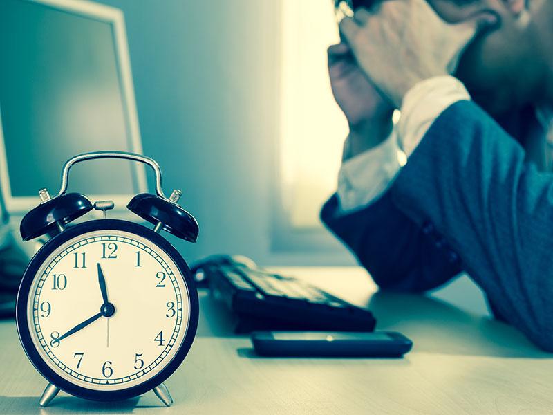 Tired & headache asian businessman work overtime