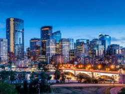 Calgary skyline at night with Bow River and Centre Street Bridge