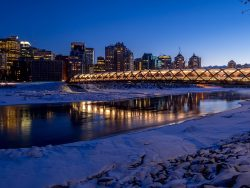 Calgary skyline at night along the Bow River in Calgary, Alberta Canada.