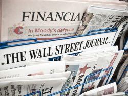 Financial Newspapers on a Newsstand