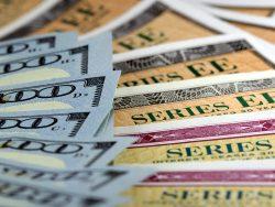 United States treasury savings bonds with one hundred dollar bills