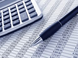 ballpoint ink pen and calculator on a financial spreadsheet statement with columns of numbers for an accounting budget finance reconciliation