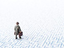 Maze and businessmen, miniature,