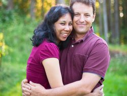 Casual Loving Husband and Wife Multi Racial Couple Portrait