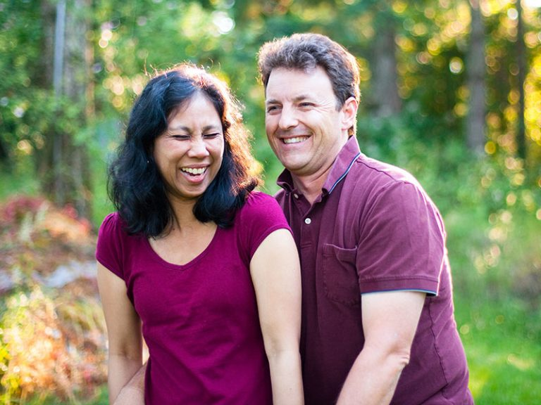 Mature Laughing Mulit Ethnic Husband and Wife