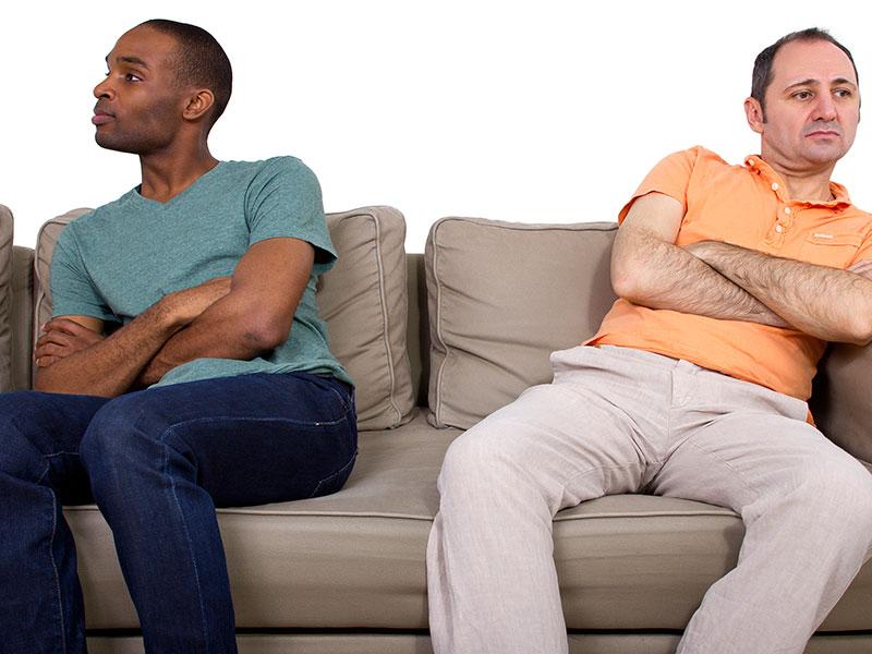 Interracial gay couple arguing