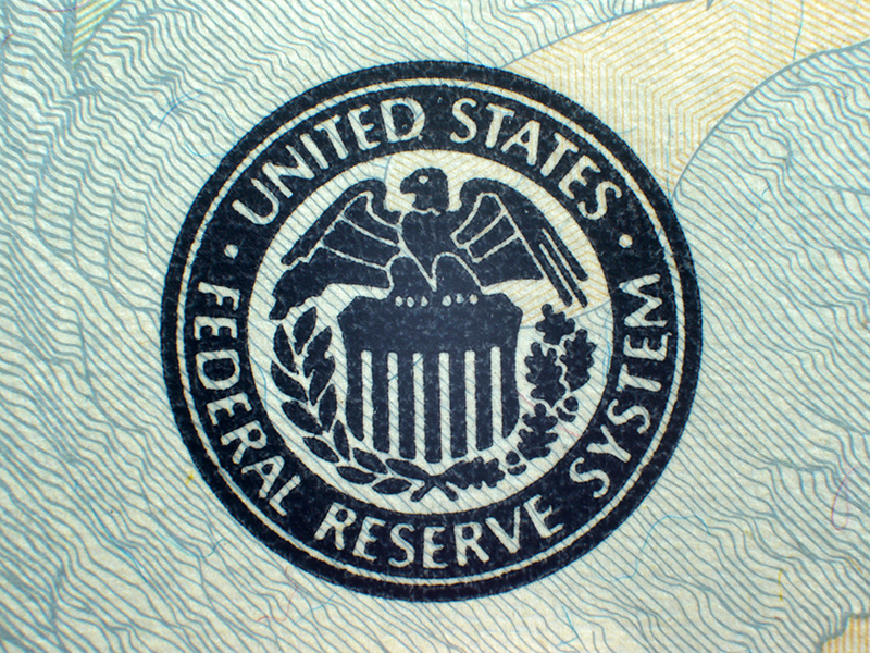 Macro close-up of Federal Reserve logo on USA Federal Reserve Note
