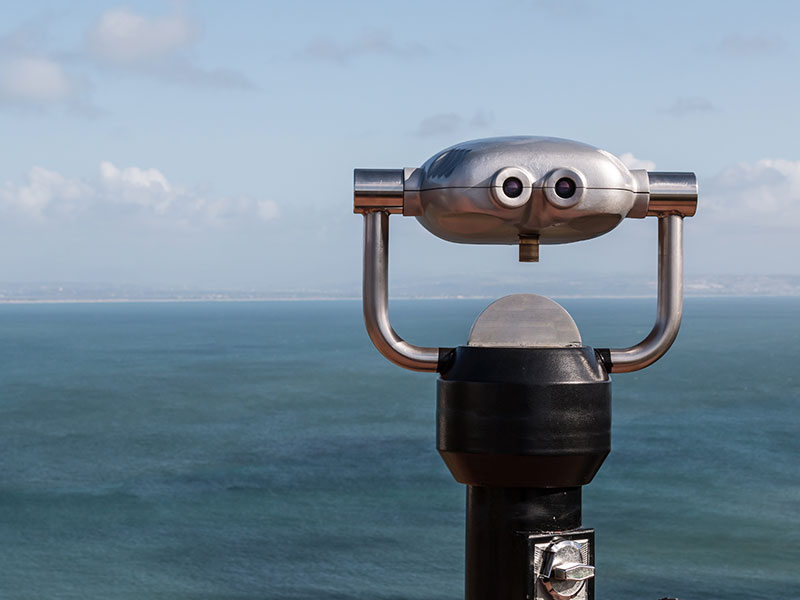 Sightseeing Binoculars Overlooking Ocean From Up High