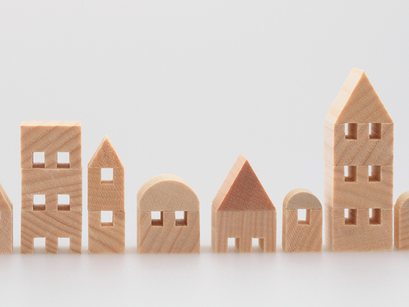 Miniature house on white background