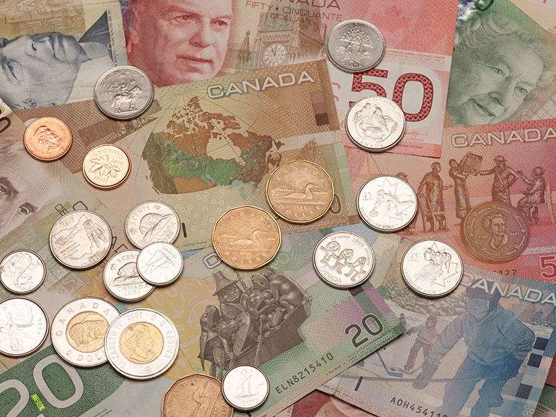 Background of Canadian money: 5,10,20,50,100 dollar bills and coins, loonie, toonie, quarter, dime, nickel, penny
