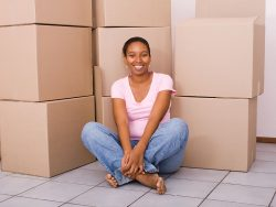 young african american woman in her new apartment