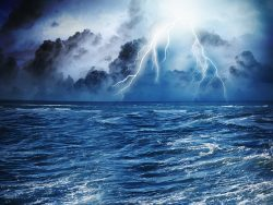 Image of dark night with lightning above stormy sea