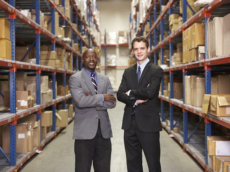 portrait of two businessmen in warehouse