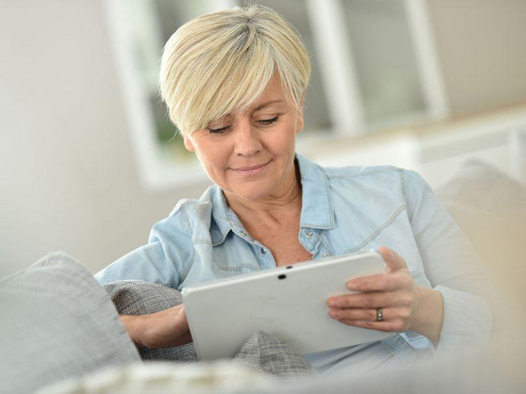 Senior woman websurfing on digital tablet