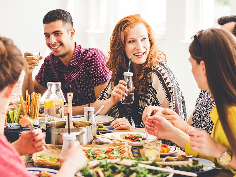 Young people eating vegan food