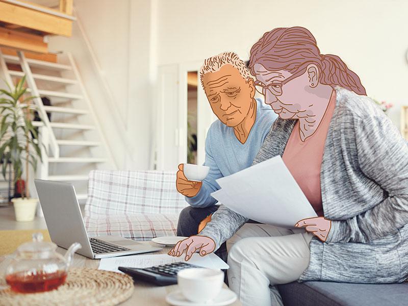 senior couple analyzing home finances