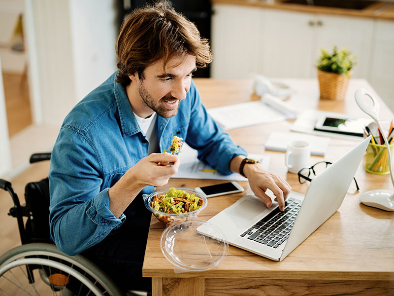 young man in wheelchair on a Zoom call