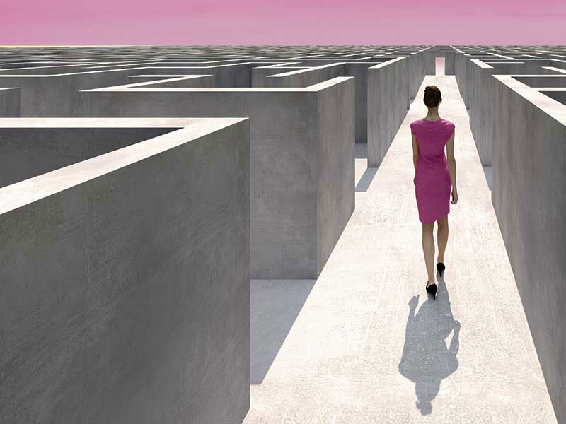 woman in a maze with a clear path