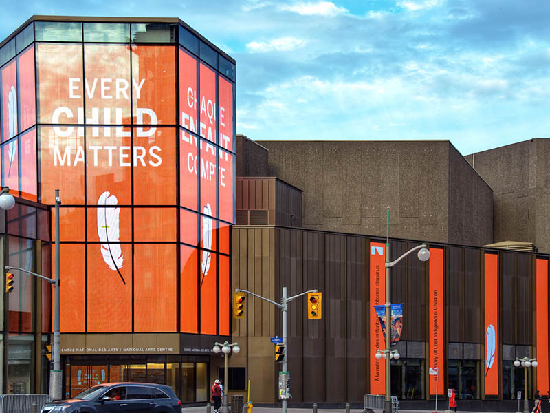 Ottawa; July 1, 2021: The National Arts Centre displays a message of support for the cause of reconciliation after the unmarked graves of Indigenous children who attended residential schools were found.